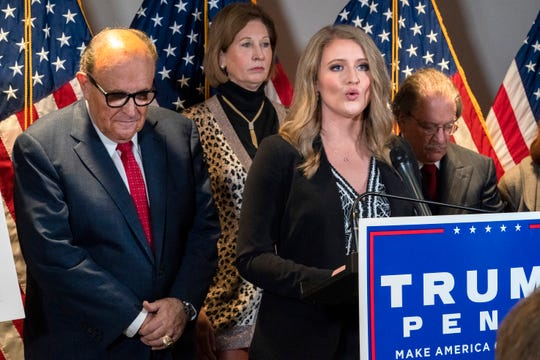 Members of President Donald Trump's legal team, including former Mayor of New York Rudy Giuliani, left, Sidney Powell, and Jenna Ellis, speaking, attend a news conference at the Republican National Committee headquarters, Thursday Nov. 19, 2020, in Washington.
