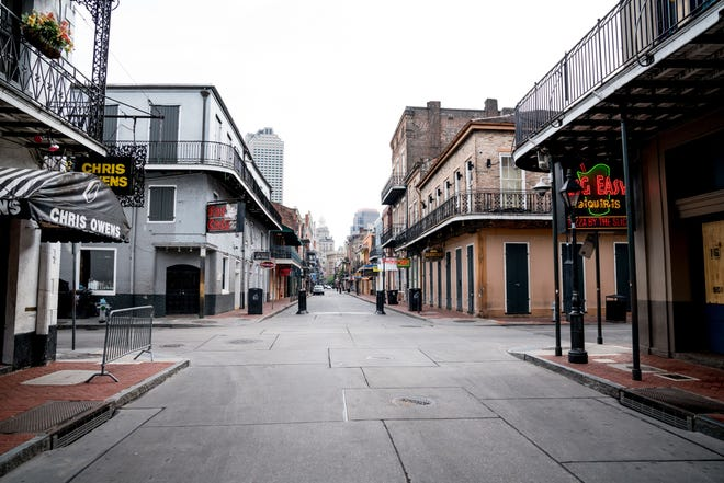 Typically filled with people, Bourbon Street is seen nearly empty on the first day of Jazz Fest 2020, in New Orleans, Louisiana on April 23, 2020. -