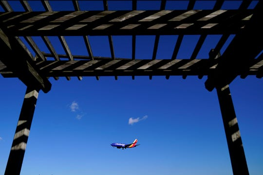 A shelter is seen at the Thomas Dixon Aircraft Observation Area as a Southwest Airlines flight from Jacksonville, Fla., makes its landing approach onto Baltimore-Washington International Thurgood Marshall Airport, Monday, Nov. 23, 2020, in Glen Burnie, Md.  With coronavirus cases spiking in the U.S. and Europe, the financial outlook of the world's airlines is getting worse. The International Air Transport Association said Tuesday that around the world, airlines will lose more than $157 billion this year and next.