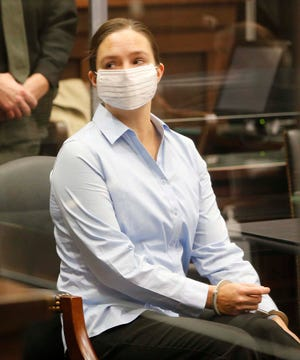 Erica Stefanko listens to Judge Amy Corrigall Jones after being found guilty of charges relating to the 2012 murder of Ashley Biggs Wednesday, Nov. 25, 2020 in Akron, Ohio.
