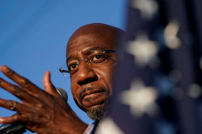 In this Sunday, Nov. 15 file photo, Raphael Warnock, a Democratic candidate for the U.S. Senate speaks during a campaign rally in Marietta, Ga. Black clergy leaders, including the Rev. Warnock, are joining forces with the United Way of New York City for a new initiative designed to combat the coronavirus' outsized toll on Black Americans through testing, contact tracing and treatment management.