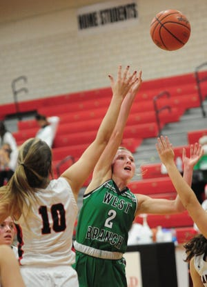 West Branch's Jillian Pidgeon puts up a shot as Canfield's Allyssa Dill defends in a non-conference game at Canfield High School Tuesday, November 24, 2020.