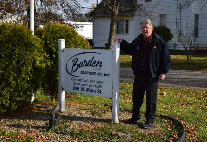Ron Rhoads stands outside his business, Burden Electric Co., Inc. in Alliance. The company is marking its 80th birthday this year.