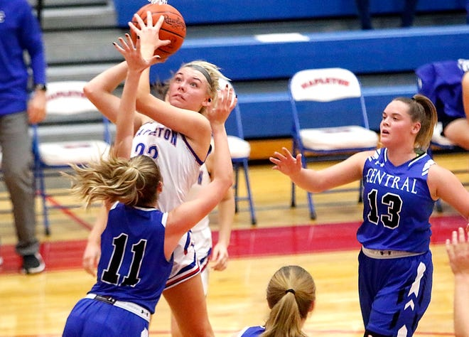 Mapleton's Roxie Hamilton (23) goes up for a shot against Central Christian's Emma Mast (11) during high school girls basketball action Tuesday at Mapleton High School. The Mounties won, 40-25.