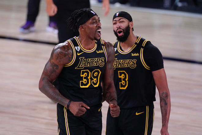 The Lakers' Dwight Howard, 39, and teammate Anthony Davis react after Howard was called for a foul during the NBA Finals against the Heat.