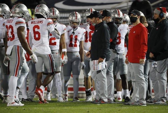 Ohio State Buckeyes head coach Ryan Day talks to his team during a timeout in the NCAA football game at Beaver Stadium in University Park, Pa. on Sunday, Nov. 1, 2020.