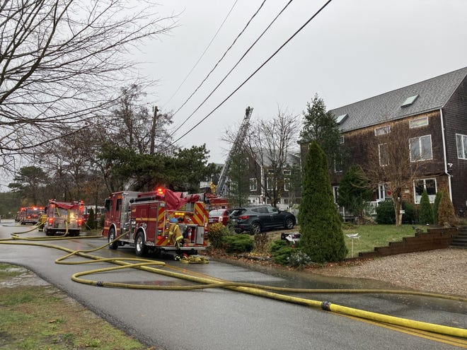 Fire crews responded to a lightning strike at the Howland Woods condominium complex in Provincetown Monday. There were no occupants in the building at the time of the fire. (Mary Ann Bragg/Provincetown Banner)