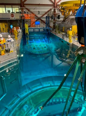 The delicate process of breaking the internal reactor at Pilgrim Nuclear Power Station into segments is being done underwater to shield the crews performing the work.