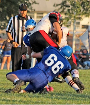 Senior defensive and offensive lineman Owen Oesch of the 2020 Southwest Livingston High School football Wildcats drags down South Holt/Nodaway-Holt ballcarrier Drew Quinlan during the Wildcats' 70-38 home win on Sept. 4. SLHS will need tough run defense this Saturday when they meet North Andrew for Missouri's 8-man state championship in Chillicothe.