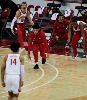 The Ohio State bench celebrates after a three-pointer from forward Justice Sueing against Illinois State on Nov. 25.