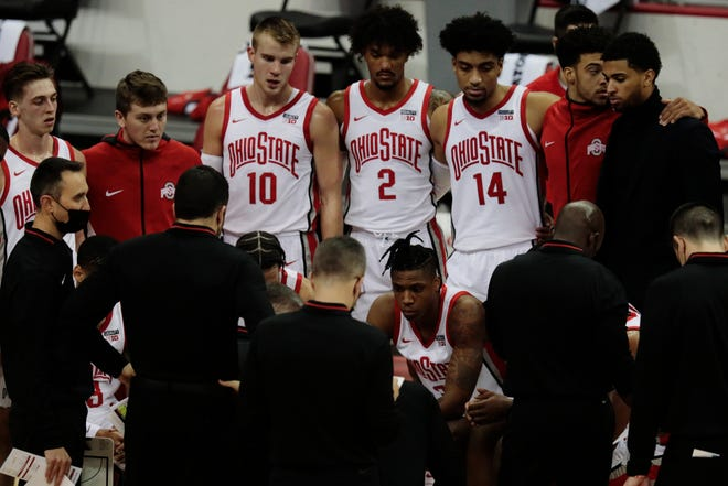 The Ohio State Buckeyes huddle during a timeout in the first half of a NCAA Division I men's basketball game between the Ohio State Buckeyes and the Illinois State Redbirds on Wednesday, Nov. 25, 2020 at Value City Arena in Columbus, Ohio.