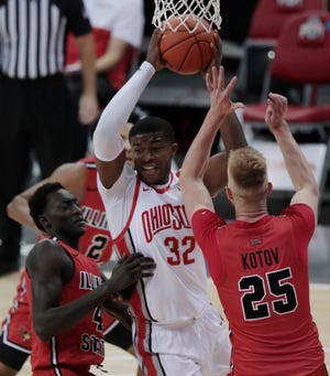 Ohio State Buckeyes forward E.J. Liddell (32) tries to pass out of Illinois State Redbirds defenders during the first half of a NCAA Division I men's basketball game between the Ohio State Buckeyes and the Illinois State Redbirds on Wednesday, Nov. 25, 2020 at Value City Arena in Columbus, Ohio.