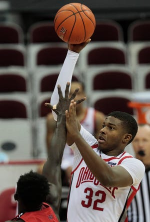 Ohio State Buckeyes forward E.J. Liddell (32) shoots over Illinois State Redbirds forward Harouna Sissoko (23) during the second half of a NCAA Division I men's basketball game between the Ohio State Buckeyes and the Illinois State Redbirds on Wednesday, Nov. 25, 2020 at Value City Arena in Columbus, Ohio.