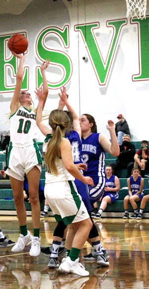 Barnesville's Halle Markovich (10) puts up a shot during Tuesday's season opening game with Buckeye Trail at Barnesville High School.