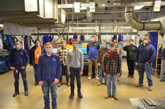 High school seniors at the Wayne County Schools Career Center wear their new fire-resistant masks in the welding lab.