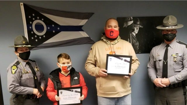 Liam and Jason Springer of Marshallville receive their Saved by the Belt certificates Wednesday.