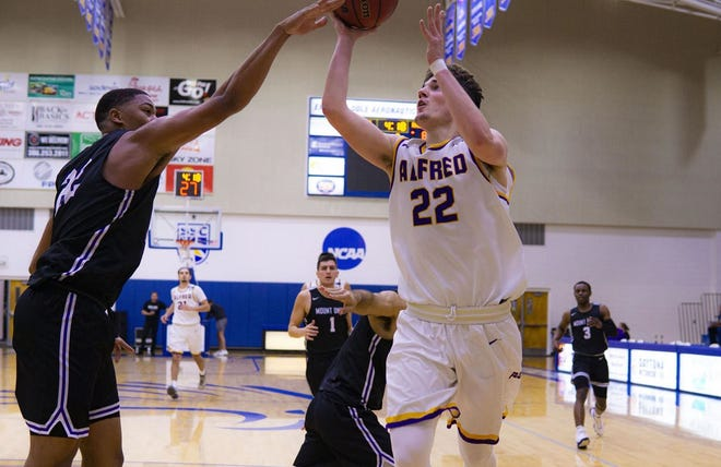 Alfred University guard Sam Dagon (22) puts up a shot last season. The Empire 8 is targeting a March 1 tipoff.
