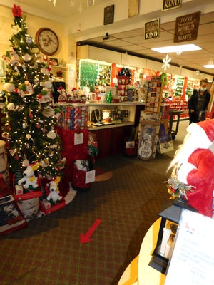 The gift shop on the second floor at Hummel's Office Plus is decked out for the holidays. Arrows have been placed on the floor to direct customers, and both shoppers and employees are required to wear masks.