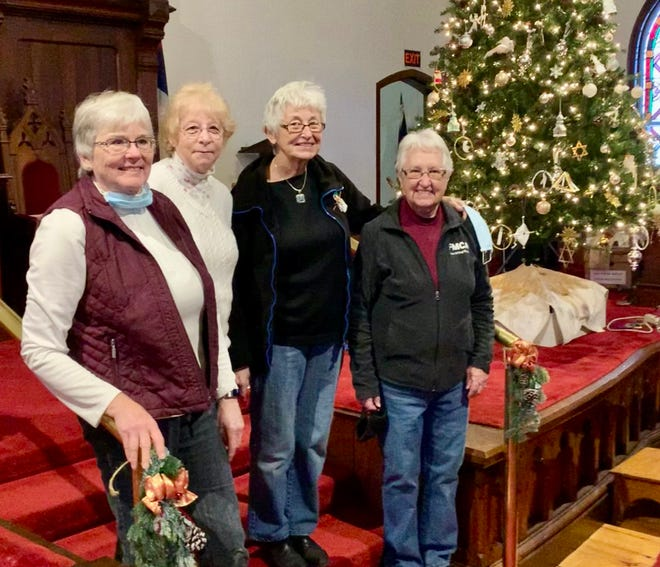 Women's Fellowship members Debbie Leary, June Guay, Sharon Glidden and Judy Cardinal are among those who have been working to make the First Congregational Church festive.