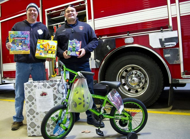 Somersworth firefighters Colby Walker, left, and John Dann are seen during a previous Somersworth Professional Firefighters Local 2320 holiday toy drive. Somersworth and numerous other communities throughout the Seacoast will still have their annual holiday toy drives and banks this year, albeit with COVID-19 modifications, to help brighten the holidays for local children.