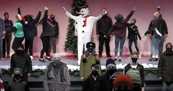 """Frosty, performed by Colby Cormier, is featured in the storybook theme song, """"Frosty the Snowman."""" Accompanying him are tap dancers with choreography by Karlie Gagne."""