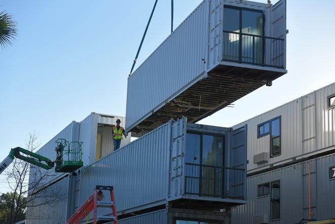 Crews stack the shipping containers that will be converted into studio apartments and Airbnb rentals at 412 E. Ashley St. in downtown Jacksonville. The work is slated to finish in December so the units will be available for rent to people drawn to the unusual approach that finds a way to turn surplus cargo containers into long-term housing.