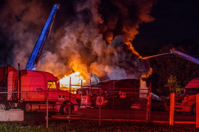 Jacksonville firefighters battle a fire early Wednesday on the city's Northwest side.