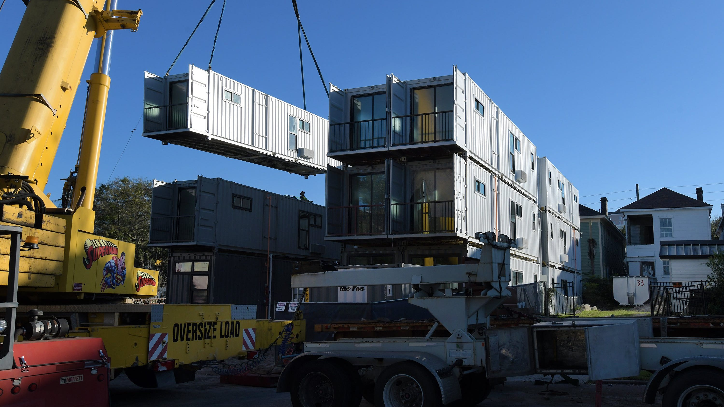 The creation of apartments and Airbnb rentals out of cargo containers is taking place on Ashley Street near more traditional homes in the downtown Cathedral District.