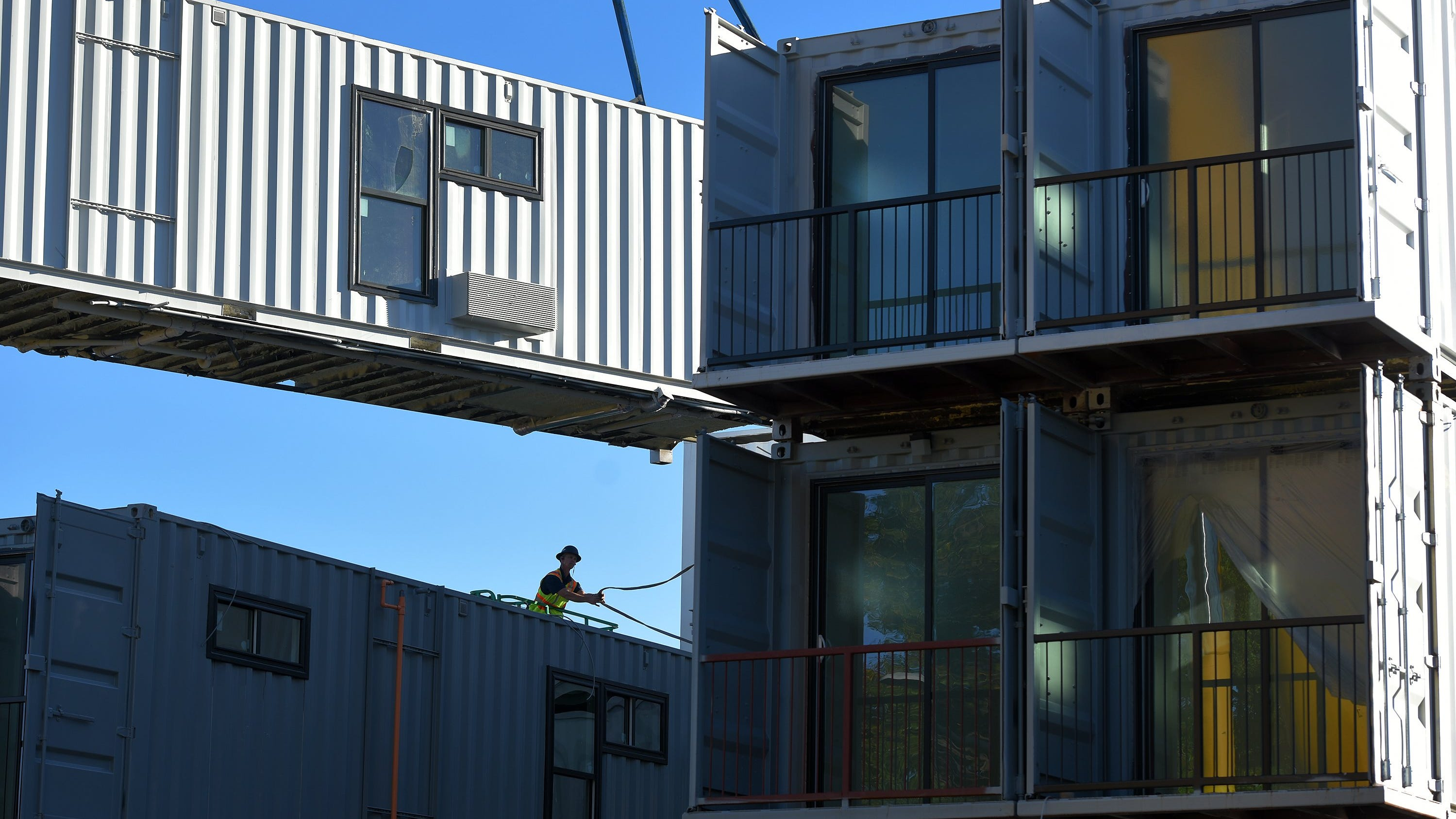 The shipping containers stacked to make an 18-unit residential development on Ashley Street in downtown Jacksonville have balconies and windows added to them as part of their conversion to studio apartments and Airbnb rentals. The work is on track to finish by the end of the year so the unusual twist to housing will be available for rent in 2021.