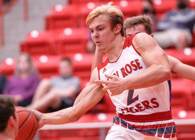Glen Rose's Austin Worthen dishes off the ball as he drives in the lane in the TIgers' win over Granbury on Monday.