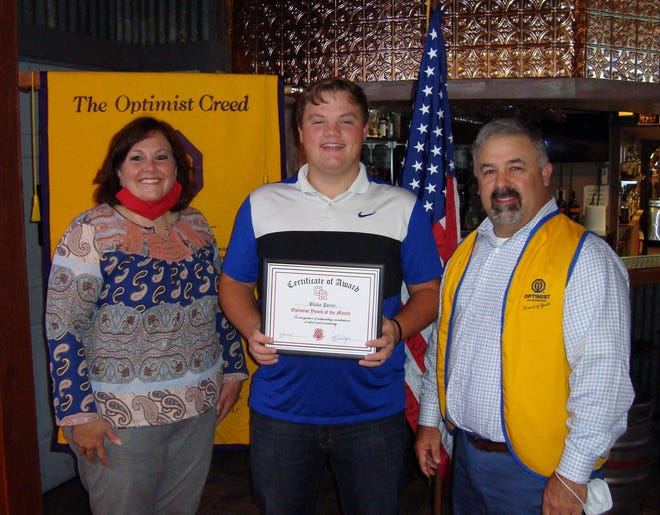 Blake Perry, center, was honored as one of the Glen Rose High School Optimist Students of the Month.