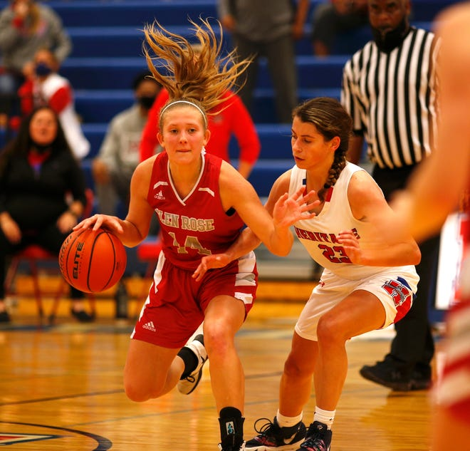 Glen Rose guard Hannah Cantwell drives around a Midlothian Heritage defender on Tuesday.