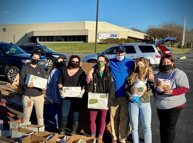 Volunteers distribute food boxes to local families through a Bob´s Big Give drive-thru giveaway held Nov. 20 at Klear Vu Corporation headquarters in Fall River, Mass.