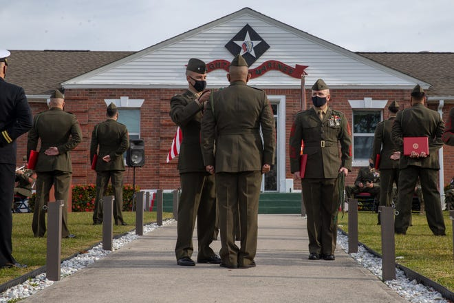 U.S. Marines and Sailors with 1st Battalion, 8th Marine Regiment (V18), 2d Marine Division, were awarded the French Fourragere on Camp Lejeune, Nov. 25. V18 is the first unit in 2d Marine Division not organic to 6th Marine Regiment to receive the French Fourragere.