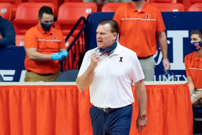 Nov 25, 2020; Champaign, Illinois, USA; Illinois Fighting Illini head coach Brad Underwood adjusts his mask as he directs his team during the first half against the North Carolina A&T Aggies at the State Farm Center. Mandatory Credit: Patrick Gorski-USA TODAY Sports