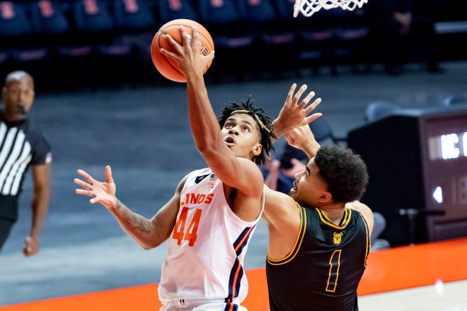 Nov 25, 2020; Champaign, Illinois, USA; Illinois Fighting Illini guard Adam Miller (44) goes up for a shot against North Carolina A&T Aggies forward Jeremy Robinson (1) during the first half at the State Farm Center. Mandatory Credit: Patrick Gorski-USA TODAY Sports