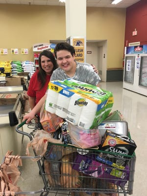Bulldog Bags is selling tickets for a chance to participate in a Shopping Spree at the Acme store in Stow. Pictured is the winner of the second annual Bulldog Bag Shopping Spree raffle, Tracy Mankovich, and her nephew, Patrick Cartwright, who did the shopping run for her.