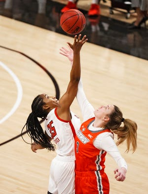 Texas Tech's Alexis Tucker (35) tips off the ball away from Texas-Rio Grande Valley's Iva Belosevic (3) during the game against UTRGV, Wednesday, Nov. 25, 2020, at United Supermarkets Arena in Lubbock, Texas.