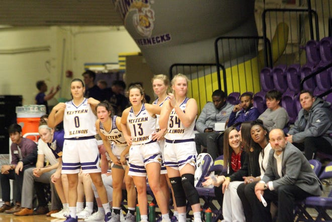 Members of the Western Illinois women's basketball team cheer on their teammates during a game last season.