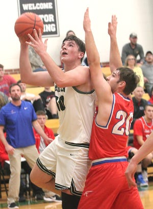 Westran 6'5 sophomore Langden Kitchen looks to score from the right block Tuesday while being guarded by South Shelby's Evan Smith. Kitchen scored a career-high 30 points to lift the Hornets to a 64-44 home victory in the 2020-21 basketball season opener for both schools.
