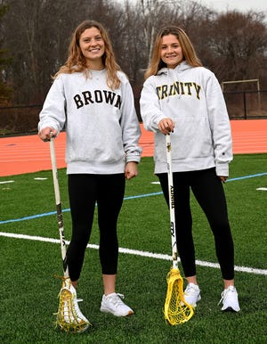 College freshmen Carly Camphausen, left,  and Caroline Lampert  both played lacrosse for Wayland High School.    Camphausen is now playing lacrosse at Division I Brown University and Lampert is playing at Div. III Trinity University.