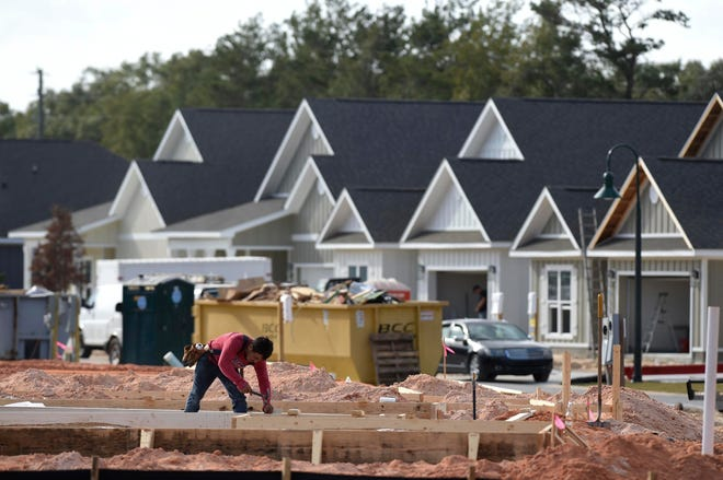 A row of homes nears completion at Hammock Bay in Freeport. The Walton County Commission would like to make building application process more user friendly.