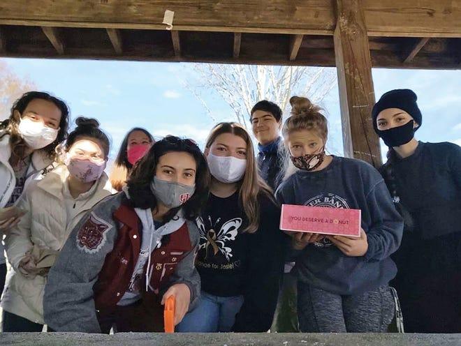 Members of the Oak Ridge Wildcat Swim team help clean up Cedar Hill Park in Oak Ridge. Pictured from left to right are Sidney Ozcan, Sarah Cherry, Coach Kelley, Carter Valencia, Sasha Umansky, Israel Perkins, Sienna Jokbar and Zoe Beatty.
