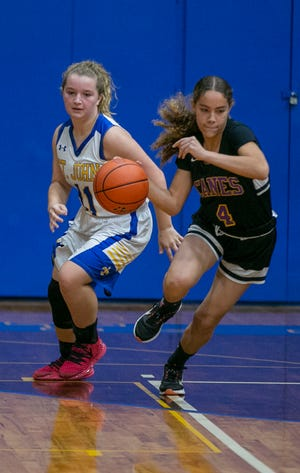 Lake Weir's Mia Poper drives by St. John's Memphis Musgrave.