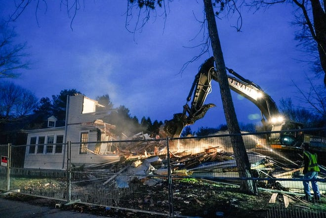 The Parsonage building in Rye's town center is demolished late Wednesday, Nov. 25, 2020