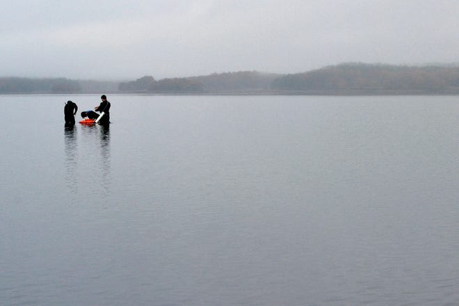 In this Oct. 29, 2019, photo, University of New Hampshire scientists monitor the health of seagrass in the Great Bay in Durham Federal officials have finalized a plan to reduce pollution in one of the largest estuaries in the Northeast.