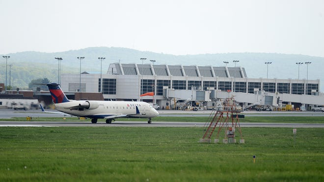 A Delta Airlines airplane leaves the Lehigh Valley International Airport.