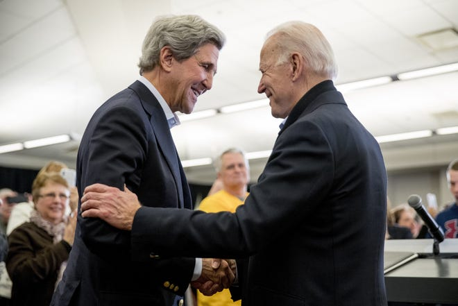 President-elect Joe Biden picked former Secretary of State John Kerry, shown with him in February, to be U.S. climate envoy in the next administration. (AP Photo/Andrew Harnik, File)