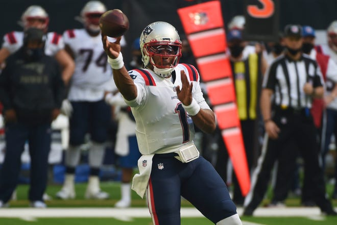 Patriots quarterback Cam Newton throws a pass against the Houston Texans last Sunday.