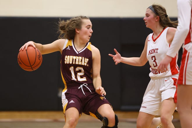Southeast senior Emma Keto with the ball against Kent Roosevelt defender sophomore Katie Keller.